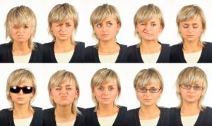 set of 20 useful facial expressions over white background