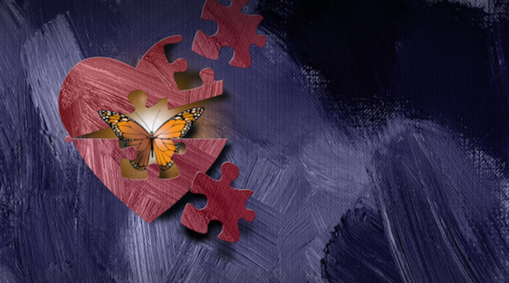 Puzzle pieces uncover peaceful butterfly