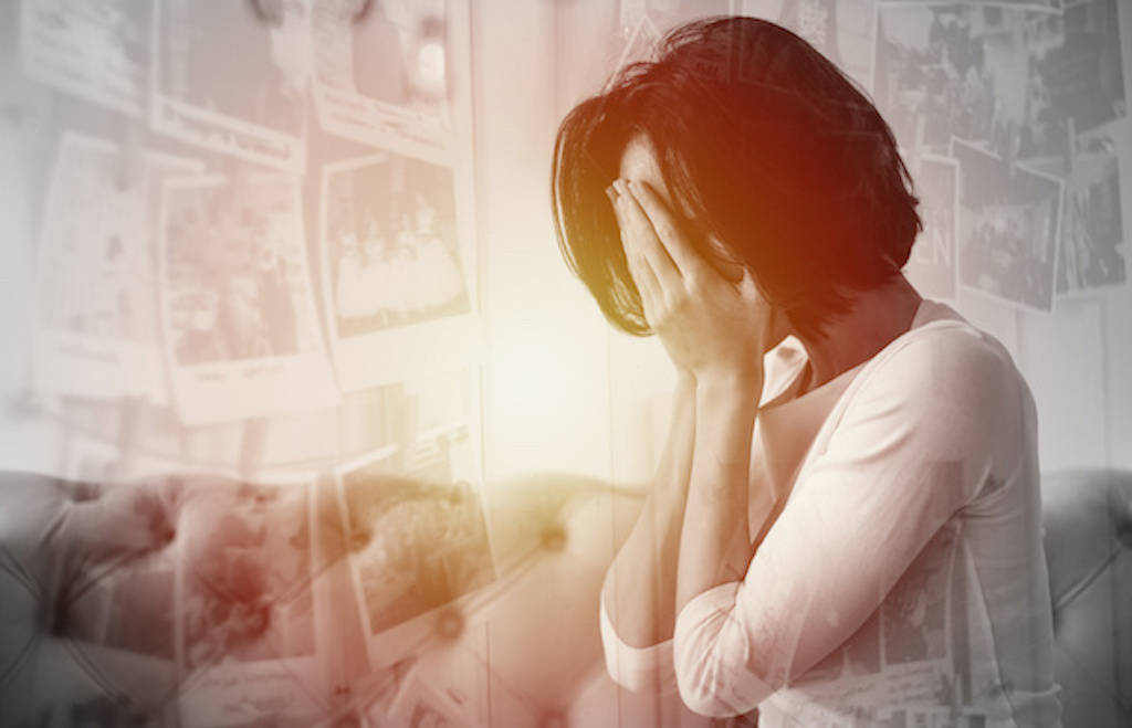 Woman thinking about her past and healing after a loveless childhood
